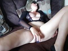 Debbie plays on the sofa